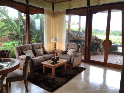 Arenal Hills Two Story Villa Fleta Living Area, Waterfall Pool in Background