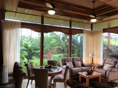 Arenal Hills Villa Living Area With Curtains Opened to Landscape